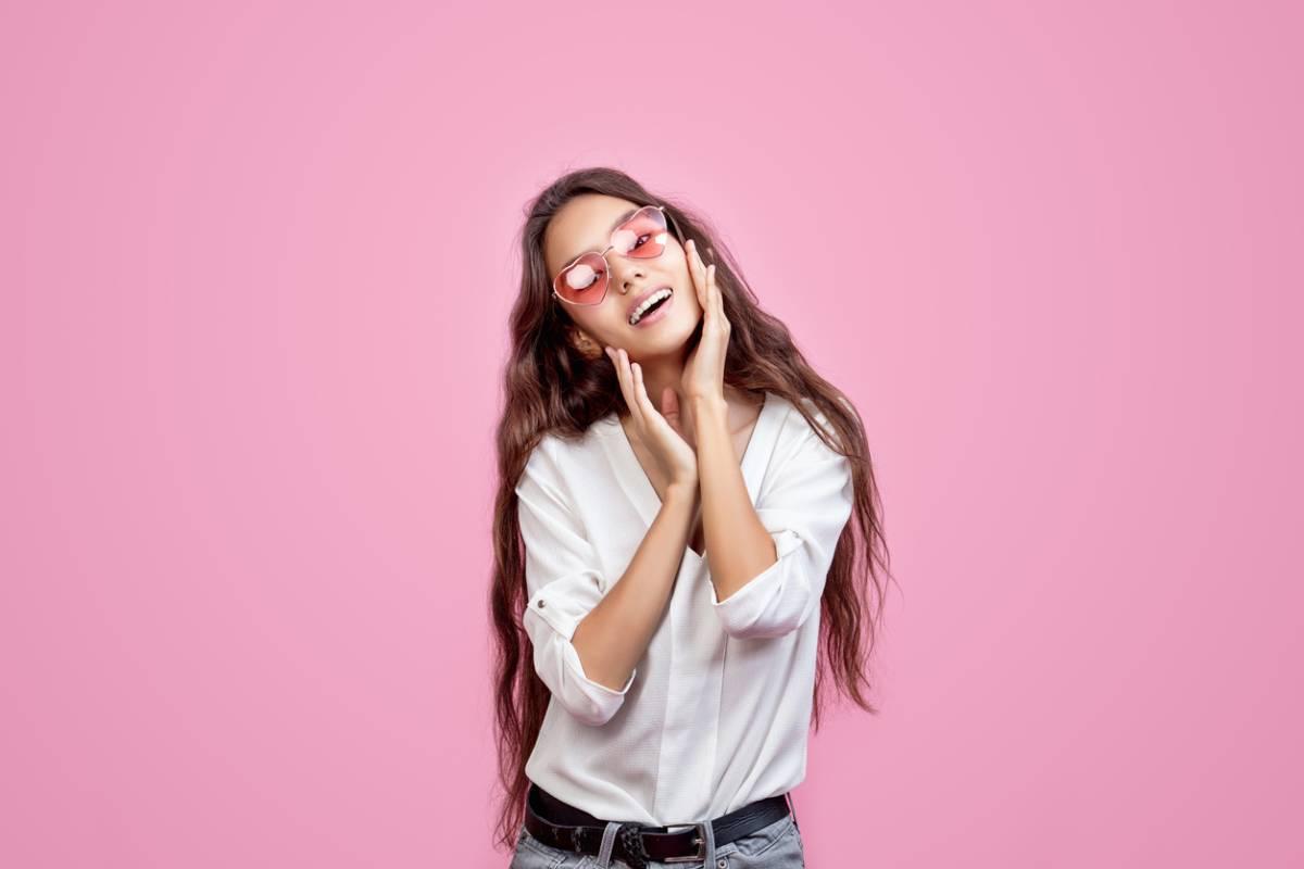 Woman smiling with bright dental veneers.